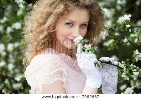 Lovely Blonde In Blooming Garden