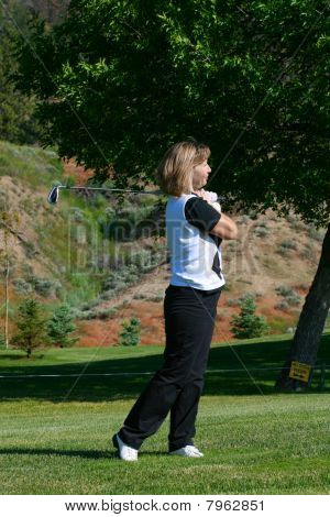 Frau Golfspieler