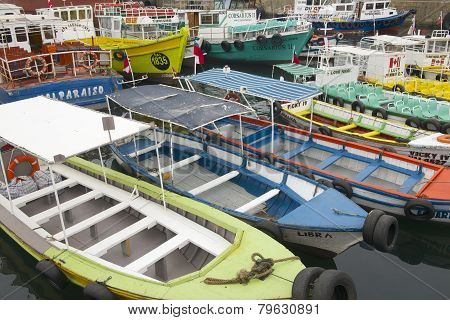 Excursion boats parked at the harbor in Valparaiso, Chile.
