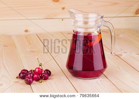 Cherry smoothie on the wooden background.