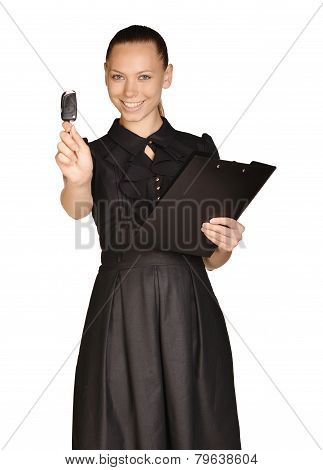 Business beautiful girl holding paper holder and car keys.