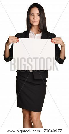 Business woman holding in hand a blank sheet of white cardboard paper.