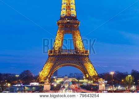 Cityscape With The Shimmering Eiffel Tower At Night In Paris