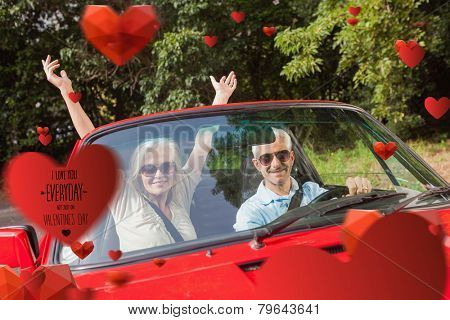 Mature couple in red cabriolet cheering at camera against i love you everyday