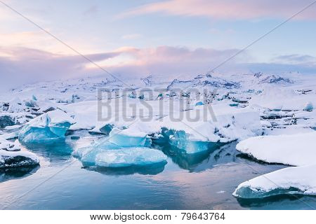 Beautiful blue lagoon with plenty of floating ice on the Jokulsaron lagoon, Iceland