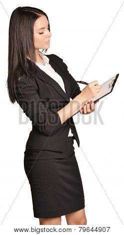 Beautiful girl writes a pen holder paper.