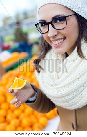 Young Beautiful Woman Shopping Fruit In A Market.