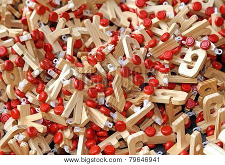 Letters In Wood With Red Wheels To Compose Words And Name Of Children