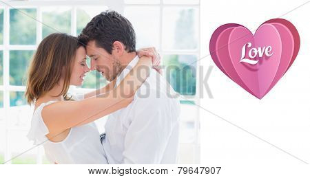 Loving young couple with arms around against love heart