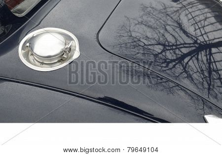 Chrome fuel filler cap on classic car.
