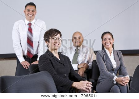 Mature Hispanic Businesswoman Leading Office Team