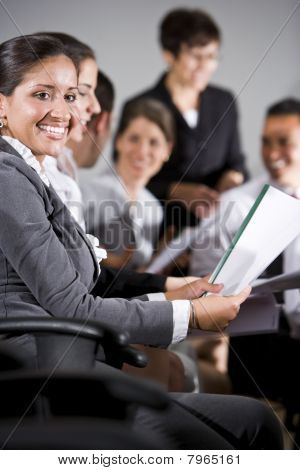 Hispanic Woman In Group Presentation