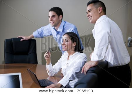 Office Workers In Boardroom Watching Presentation