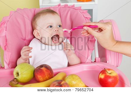 Cute hungry baby eating