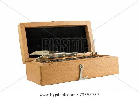 Set Of Small Weights For Weighing In A Wooden Box.