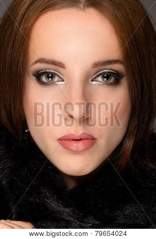 Close Up Face Portrait Of A Serene Brunette