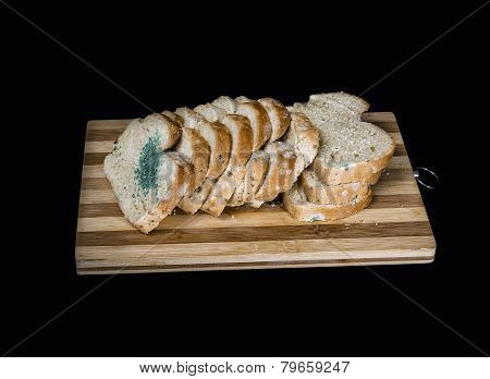 Mold Fungus On Slices Of Bread Isolated On Black  Background
