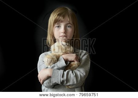 Young little girl holding hugging teddy bear
