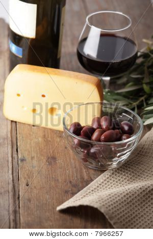 Olives, Cheese, And Red Wine