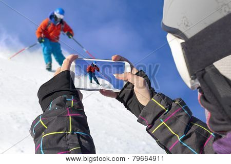Photographed Skiers With Cell Phone
