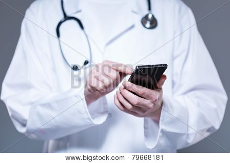 Doctor Hands Using Mobile Phone