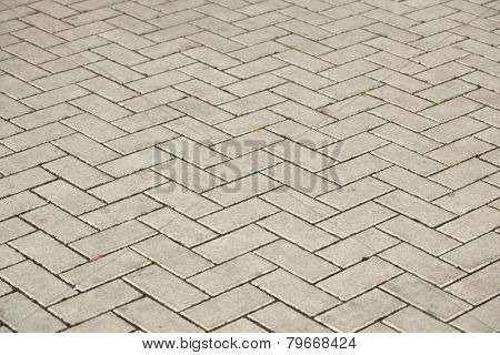 Concrete block pavement laid as parquet. Background texture.