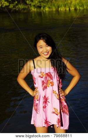 Smiling Japanese American Woman With Hands Akimbo