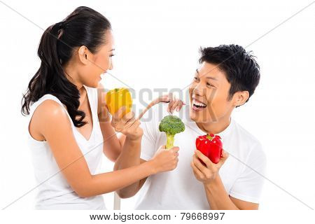 Asian couple eating and living healthy