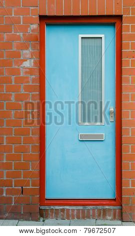 Blue Door On Brick Wall