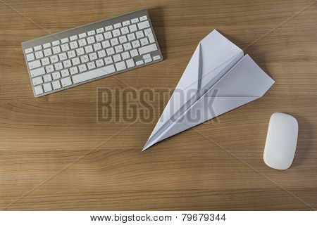 Paper Plane On An Office Desk