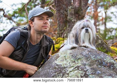Young man tourist with shih-tzu dog portrait.