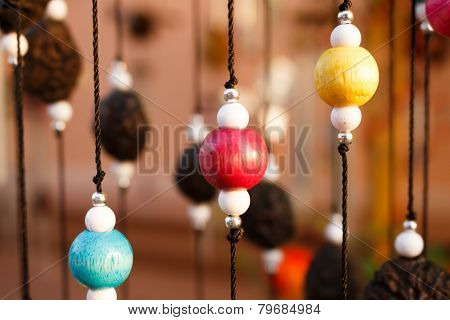Wood And Plastic Beads Background.