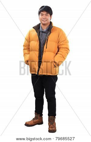 Portrait Of Young Asian Man Wearing Yellow Winter Jacket And Black Jeans Leather Shoes Standing With