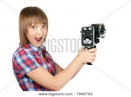 Beautiful Girl In Plaid Shirt With Movie Camera