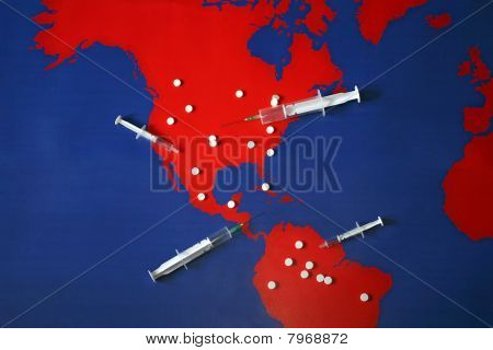 Map With Tabletes, Syringes And Needles