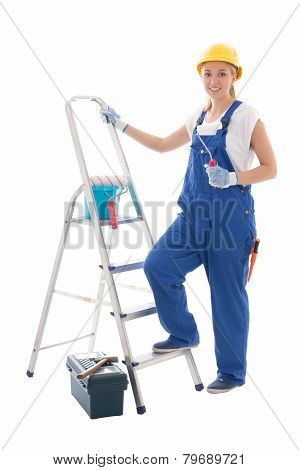 Young Woman Painter In Blue Builder Uniform With Ladder And Tools Isolated On White