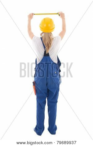 Back View Of Woman In Blue Builder Uniform Holding Measure Tape Isolated On White