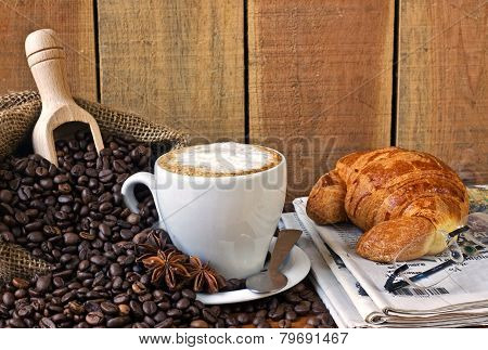 cappuccino, brioches and newspaper with background