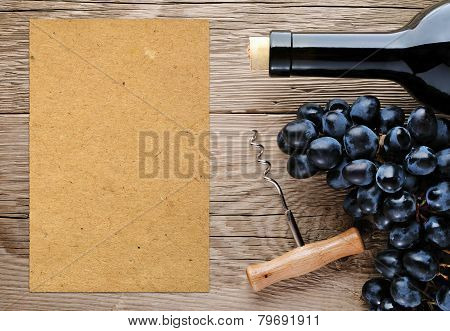 Bottle Of Wine, Corkscrew, Grape And Blank Paper