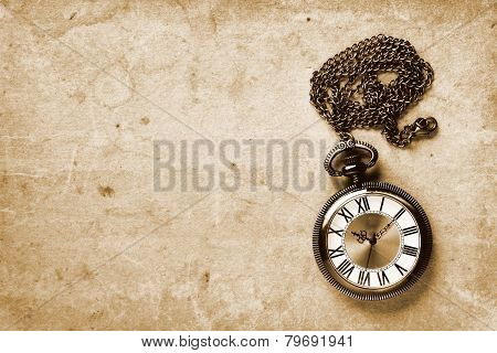 Vintage Watch On Old Paper Background