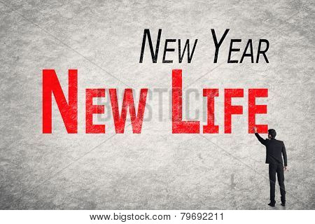 Asian business man write words on wall, New Year New Life
