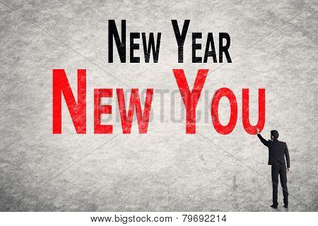 Asian business man write words on wall, New Year New You
