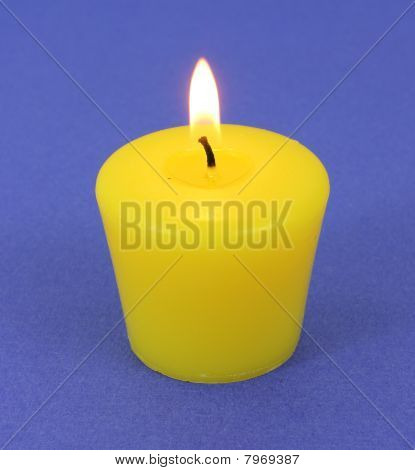 A citronella candle that has been lit