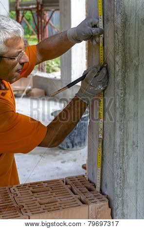 Construction worker placing slab formwork beams
