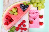 picture of watermelon slices  - Fresh juicy watermelon slice  with cut out heart shape - JPG