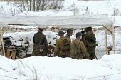 pic of cold-war  - RUSSIA LIZLOVO - DECEMBER 14: Unidentified soldiers hide under the tent on reenactment of the counterattack under the Moscow in 1941 in World War II in Moscow region Lizlovo village Russia 2014 ** Note: Visible grain at 100%, best at smaller sizes - JPG