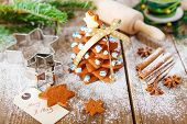 stock photo of xmas star  - Homemade baked Christmas gingerbread tree on vintage wooden background - JPG