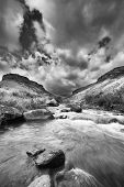 picture of conversation  - Valley in the Drakensberg mountain in South Africa with water stream artistic conversion - JPG