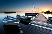 picture of pier a lake  - sunrise over lake harbor with boats and pier - JPG