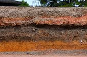 picture of paved road  - Layer of soil beneath the asphalt road - JPG